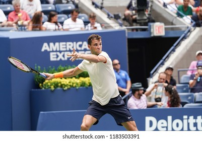 New York, NY - August 27, 2018: Grigor Dimitrov of Bulgaria returns ball during US Open 2018 1st round match against Stan Wawrinka of Switzerland at USTA Billie Jean King National Tennis Center