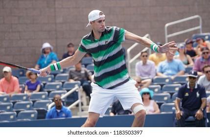 New York, NY - August 27, 2018: John Isner of USA returns ball during US Open 2018 1st round match against Bradley Klahn of USA at USTA Billie Jean King National Tennis Center