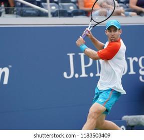 New York, NY - August 27, 2018: Bradley Klahn of USA returns ball during US Open 2018 1st round match against John Isner of USA at USTA Billie Jean King National Tennis Center