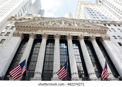 New York, NY: August 27, 2016: Four flags at the NYSE on Wall Street. The New York Stock Exchange (NYSE) is the largest stock exchange in the world by market cap.