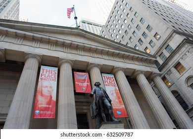 New York, NY: August 27, 2016: People walking by an American-flag draped New York Stock Exchange. The NYSE is the world's largest stock exchange. Focus is on the George Washington statue.