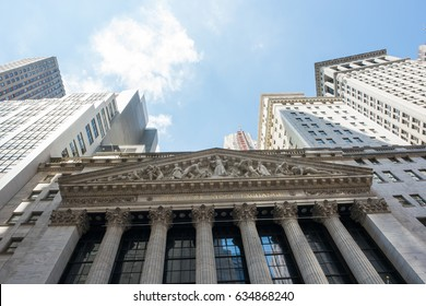 New York, NY: August 27, 2016: NYSE on Wall Street. The New York Stock Exchange (NYSE) is the largest stock exchange in the world by market cap.