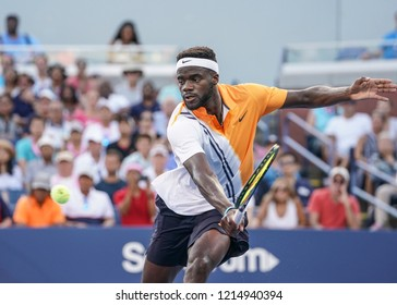 New York, NY - August 30, 2018: Frances Tiafoe of USA returns ball during US Open 2018 2nd round match against Alex de Minaur of Australia at USTA Billie Jean King National Tennis Center