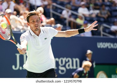 New York, NY - August 30, 2018: Nicolas Mahut of France returns ball during US Open 2018 2nd round match against Alexander Zverev of Germany at USTA Billie Jean King National Tennis Center