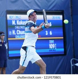 New York, NY - August 30, 2018: Mikhail Kukushkin of Kazakhstan returns ball during US Open 2018 2nd round match against Hyeon Chung of Korea at USTA Billie Jean King National Tennis Center