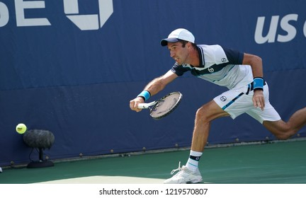 New York, NY - August 30, 2018: Mikhail Kukushkin of Kazakhstan misses return during US Open 2018 2nd round match against Hyeon Chung of Korea at USTA Billie Jean King National Tennis Center