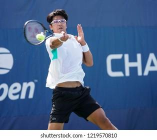New York, NY - August 30, 2018: Hyeon Chung of Korea returns ball during US Open 2018 2nd round match against Mikhail Kukushkin of Kazakhstan at USTA Billie Jean King National Tennis Center