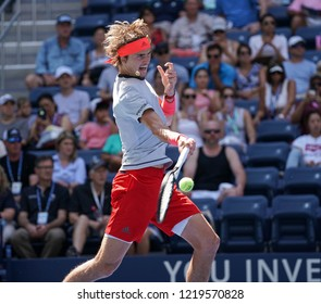 New York, NY - August 30, 2018: Alexander Zverev of Germany returns ball during US Open 2018 2nd round match against Nicolas Mahut of France at USTA Billie Jean King National Tennis Center