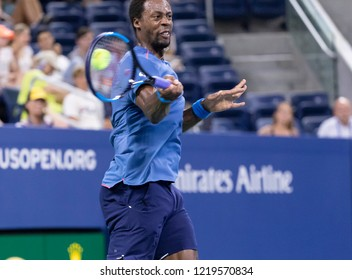 New York, NY - August 30, 2018: Gael Monfils of France returns ball during US Open 2018 2nd round match against Kei Nishikori of Japan at USTA Billie Jean King National Tennis Center