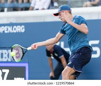 New York, NY - August 30, 2018: Alex de Minaur of Australia returns ball during US Open 2018 2nd round match against Frances Tiafoe of USA at USTA Billie Jean King National Tennis Center