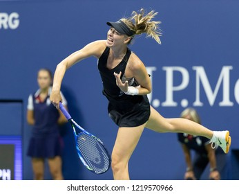 New York, NY - August 30, 2018: Maria Sharapova of Russia serves during US Open 2018 2nd round match against Sorana Cirstea of Romania at USTA Billie Jean King National Tennis Center