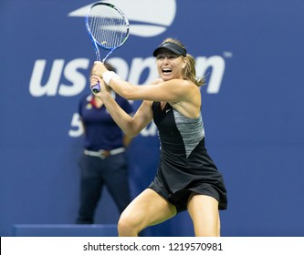 New York, NY - August 30, 2018: Maria Sharapova of Russia returns ball during US Open 2018 2nd round match against Sorana Cirstea of Romania at USTA Billie Jean King National Tennis Center