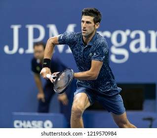 New York, NY - August 30, 2018: Novak Djokovic of Serbia reaches for ball during US Open 2018 2nd round match against Tennys Sandgren of USA at USTA Billie Jean King National Tennis Center