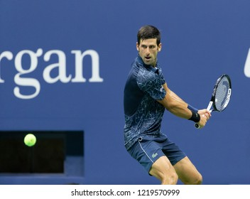 New York, NY - August 30, 2018: Novak Djokovic of Serbia returns ball during US Open 2018 2nd round match against Tennys Sandgren of USA at USTA Billie Jean King National Tennis Center