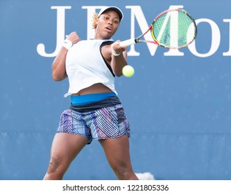 New York, NY - August 30, 2018: Taylor Townsend of USA returns ball during US Open 2018 2nd round match against Jelena Ostapenko of Latvia at USTA Billie Jean King National Tennis Center