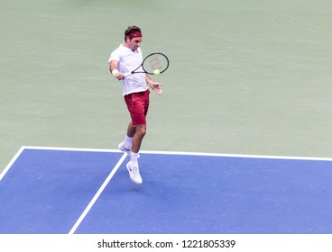 New York, NY - August 30, 2018: Roger Federer of Switzerland returns ball during US Open 2018 2nd round match against Benoit Paire of France at USTA Billie Jean King National Tennis Center