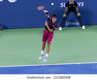 New York, NY - August 30, 2018: Kei Nishikori of Japan serves during US Open 2018 2nd round match against Gael Monfils of France at USTA Billie Jean King National Tennis Center