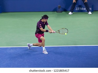 New York, NY - August 30, 2018: Kei Nishikori of Japan returns ball during US Open 2018 2nd round match against Gael Monfils of France at USTA Billie Jean King National Tennis Center