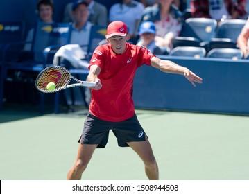 New York, NY - August 30, 2019: Alex de Minaur (Australia) in action during round 3 of US Open Tennis Championship against Kei Nishikori (Japan) at Billie Jean King National Tennis Center
