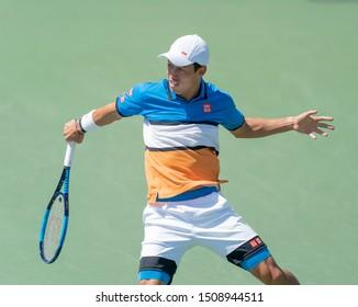New York, NY - August 30, 2019: Kei Nishikori (Japan) in action during round 3 of US Open Tennis Championship against Alex de Minaur (Australia) at Billie Jean King National Tennis Center