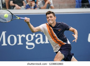 New York, NY - August 31, 2018: Taylor Fritz of USA returns ball during US Open 2018 3rd round match against Dominic Thiem of Austria at USTA Billie Jean King National Tennis Center