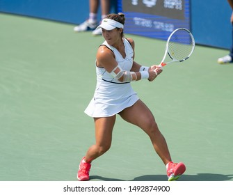 New York, NY - August 31, 2019: Kristie Ahn (USA) in action during round 3 of US Open Championship against Jelena Ostapenko (Latvia) at Billie Jean King National Tennis Center