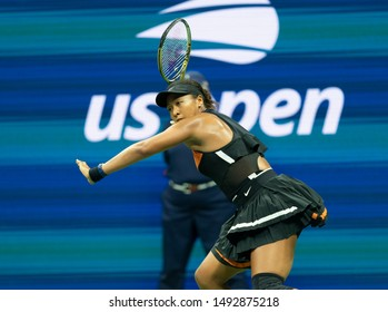 New York, NY - August 31, 2019: Naomi Osaka (Japan) in action during round 3 of US Open Championship against Cori Coco Gauff (USA) at Billie Jean King National Tennis Center