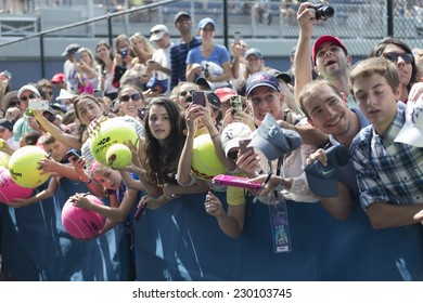 NEW YORK, NY - AUGUST 31, 2014: Fans waiting to get autograph by Roger Federer at US Open tennis tournament in Flushing Meadows USTA