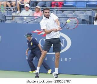 NEW YORK, NY - AUGUST 31, 2014: Gilles Simon of France returns ball during 3rd round match against David Ferrer of Spain at US Open tennis tournament in Flushing Meadows USTA Tennis Center