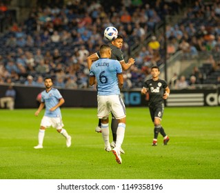 New York, NY - August 4, 2018: Anthony Blondell (9) of Vancouver Whitecaps FC & Alexander Callens (6) of NYC FC fight for ball during regular MLS game against NYC FC on Yankee stadium