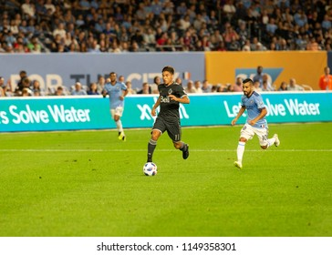 New York, NY - August 4, 2018: Nicolas Mezquida (11) of Vancouver Whitecaps FC counterattacks during regular MLS game against NYC FC on Yankee stadium Game ended in draw 2 - 2