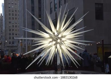 NEW YORK, NY - DEC 25: Swarovski Crystal Boutique with Swarovski Crystal Star at Rockefeller Center in Manhattan, New York, as seen on Dec 25, 2019.