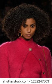 NEW YORK, NY - DECEMBER 02: Model Imaan Hammam walks the runway at the Versace Pre-Fall 2019 Collection at The American Stock Exchange on December 02, 2018 in New York City.