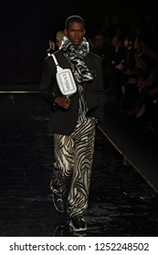 NEW YORK, NY - DECEMBER 02: Model Salomon Diaz walks the runway at the Versace Pre-Fall 2019 Collection at The American Stock Exchange on December 02, 2018 in New York City.