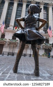 New York, NY - December 12, 2018: Fearless Girl sculpture gets permanent place across NY Stock Exchange on Broad street