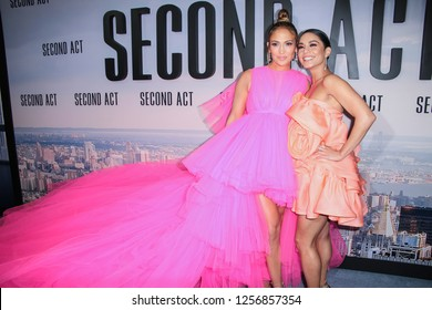 New York, NY - December 12, 2018: Jennifer Lopez wearing gown by Giambattista Valli and Vanessa Hudgens wearing dress by Marc Jacobs attend premiere of 'Second Act' at Regal Union Square Theatre