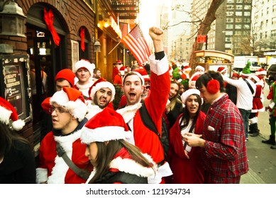 NEW YORK, NY - DECEMBER 15: Revelers dressed as Santa Claus during the annual SantaCon event December 15, 2012 in New York City.