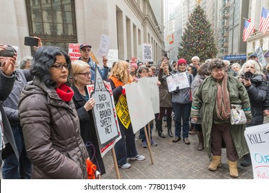 New York, NY - December 19, 2017: Rally against tax bill in US Congress in front of New York Stock Exchange