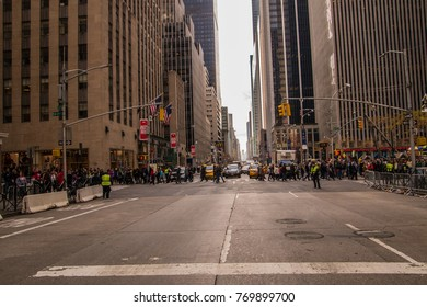New York, NY - December 2, 2017: Crowd of holiday shoppers crossing avenue in Manhattan, NY at Christmas time