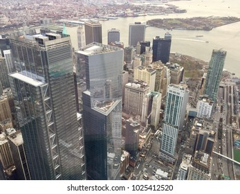NEW YORK, NY - DECEMBER 20, 2017: View from above at skyscrapers in downtown Manhattan from the Freedom Tower One World Observatory in New York City with river in the background.