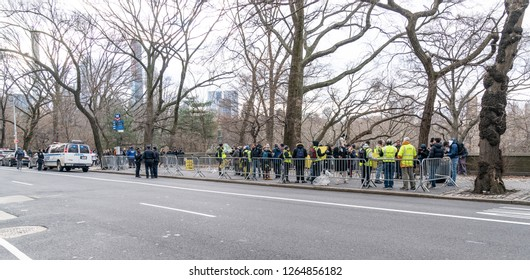 New York, NY - December 22, 2018: Dozen of protesters show up for Yellow Vest NYC Protest in solidarity with gilets jaunes in France at French Consulate on 5th Avenue