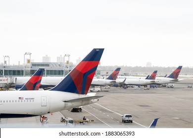 NEW YORK, NY – DECEMBER 24: A Delta Airlines airplanes are seen at gates at John F. Kennedy International Airport (JFK) on December 24, 2020 in New York City.