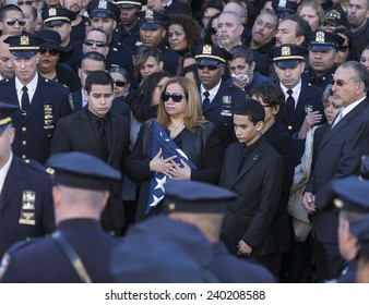 NEW YORK, NY - DECEMBER 27, 2014: Maritza Ramos, Justin Ramos and Jared Ramos hold colors at  Christ Tabernacle Church for the funeral of slain New York City Police Officer Rafael Ramos