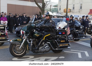 NEW YORK, NY - DECEMBER 27, 2014: Police officer on Motorcycle from Jersey City attends Christ Tabernacle Church for the funeral of slain New York City Police Officer Rafael Ramos