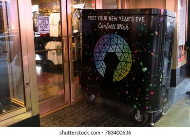 New York, NY - December 29, 2017: Collection box installed for people confetti wish to distribute on Times Square for New Year celebration at Hard Rock Cafe Marquee
