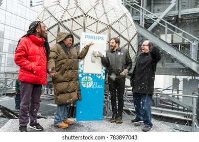 New York, NY - December 30, 2017: Kaia Burke, Tarana Burke (founder of Me Too movement), Jeffrey Strauss, Tim Tompkins help test New Year ball on One Times Square