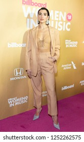 New York, NY - December 6, 2018: Dua Lipa wearing suit by Alberta Ferretti attends Billboard's 13th Annual Women in Music gala at Pier 36