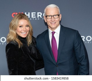 New York, NY - December 8, 2019: Kelly Ripa wearing dress by Balmain and Anderson Cooper attend the 13th Annual CNN Heroes at the American Museum of Natural History