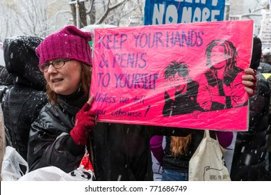 New York, NY - December 9, 2017: #MeToo rally drew dozens of protesters to the Trump International Hotel at Columbus Circle despite cold and snow