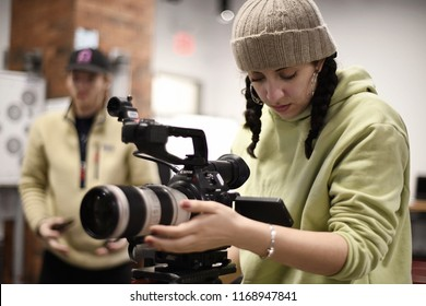 New York, NY; Feb 2018: An assistant camera woman preps her camera gear for a big shoot